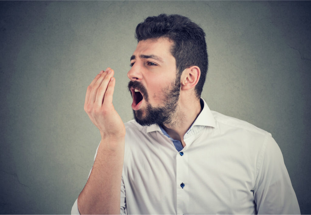 man checking bad breath because of wisdom teeth