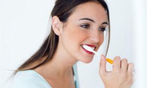 female brushing her teeth